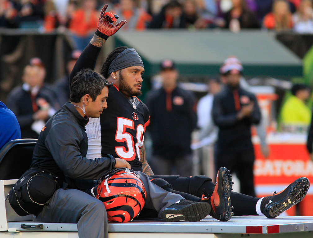 . Cincinnati Bengals middle linebacker Rey Maualuga is taken off the field after being injured in the first half of an NFL football game against the New York Jets, Sunday, Oct. 27, 2013, in Cincinnati. (AP Photo/Tom Uhlman)