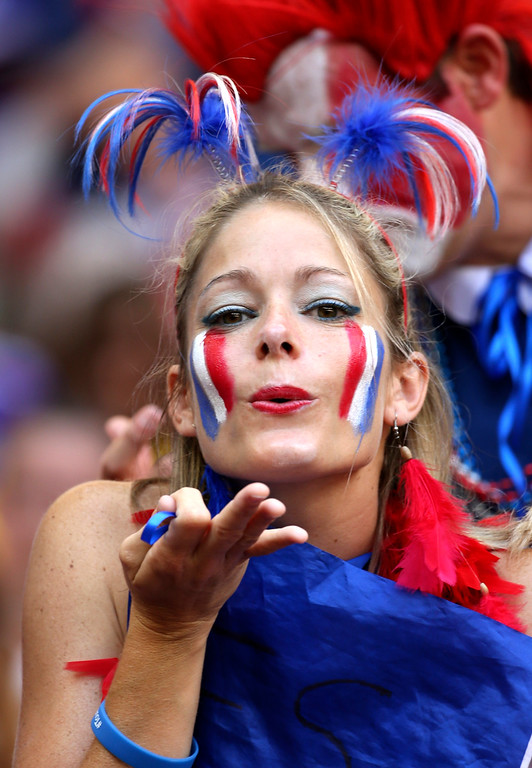 . A French supporter blows a kiss before the World Cup round of 16 soccer match between France and Nigeria at the Estadio Nacional in Brasilia, Brazil, Monday, June 30, 2014. (AP Photo/David Vincent)