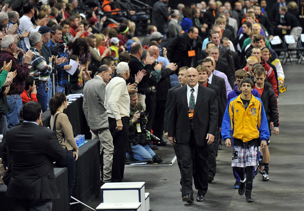 . DENVER, CO. - FEBRUARY 23: High School coaches and wrestlers are in the parade for the final of High School State Championship at Pepsi Center February 23, 2013. Denver, Colorado. (Photo By Hyoung Chang/The Denver Post)