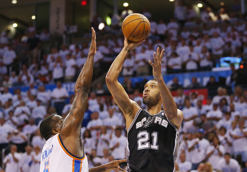. OKLAHOMA CITY, OK - MAY 31:  Tim Duncan #21 of the San Antono Spurs takes a shot over Kendrick Perkins #5 of the Oklahoma City Thunder in the first half during Game Six of the Western Conference Finals of the 2014 NBA Playoffs at Chesapeake Energy Arena on May 31, 2014 in Oklahoma City, Oklahoma. (Photo by Ronald Martinez/Getty Images)