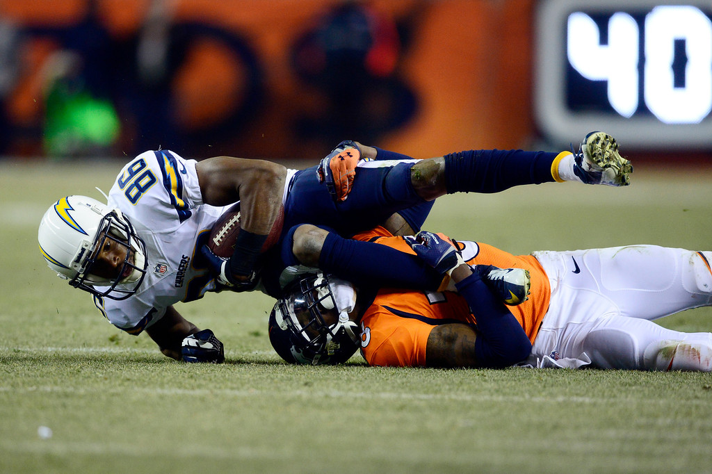 . DENVER, CO - DECEMBER 12: San Diego Chargers wide receiver Vincent Brown (86) gains a first down over Denver Broncos cornerback Kayvon Webster (36) during the second half.  The Denver Broncos vs. the San Diego Chargers at Sports Authority Field at Mile High in Denver on December 12, 2013. (Photo by AAron Ontiveroz/The Denver Post)