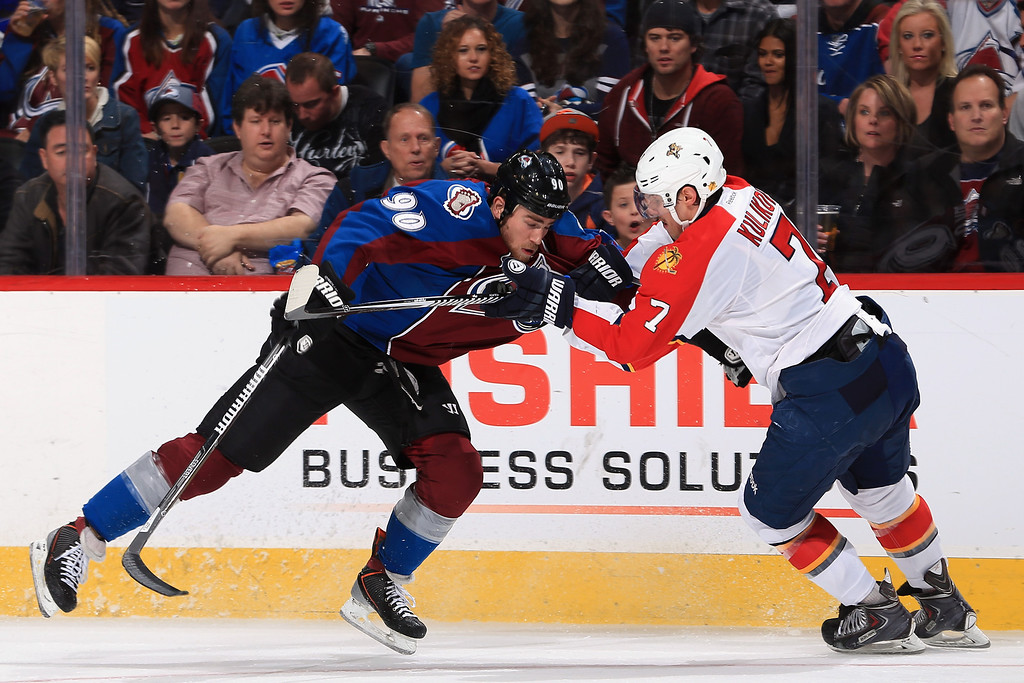 . DENVER, CO - NOVEMBER 16:  Ryan O\'Reilly #90 of the Colorado Avalanche and Dmitry Kulikov #7 of the Florida Panthers battle for control of the puck at Pepsi Center on November 16, 2013 in Denver, Colorado.  (Photo by Doug Pensinger/Getty Images)
