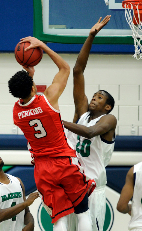 . Blazers center De\'Ron Davis (20) tried to block a shot from Regis guard Josh Perkins (3) in the second half. The Overland High School boy\'s basketball team defeated Regis Jesuit 80-66 Tuesday night, December 11, 2012.  Karl Gehring/The Denver Post