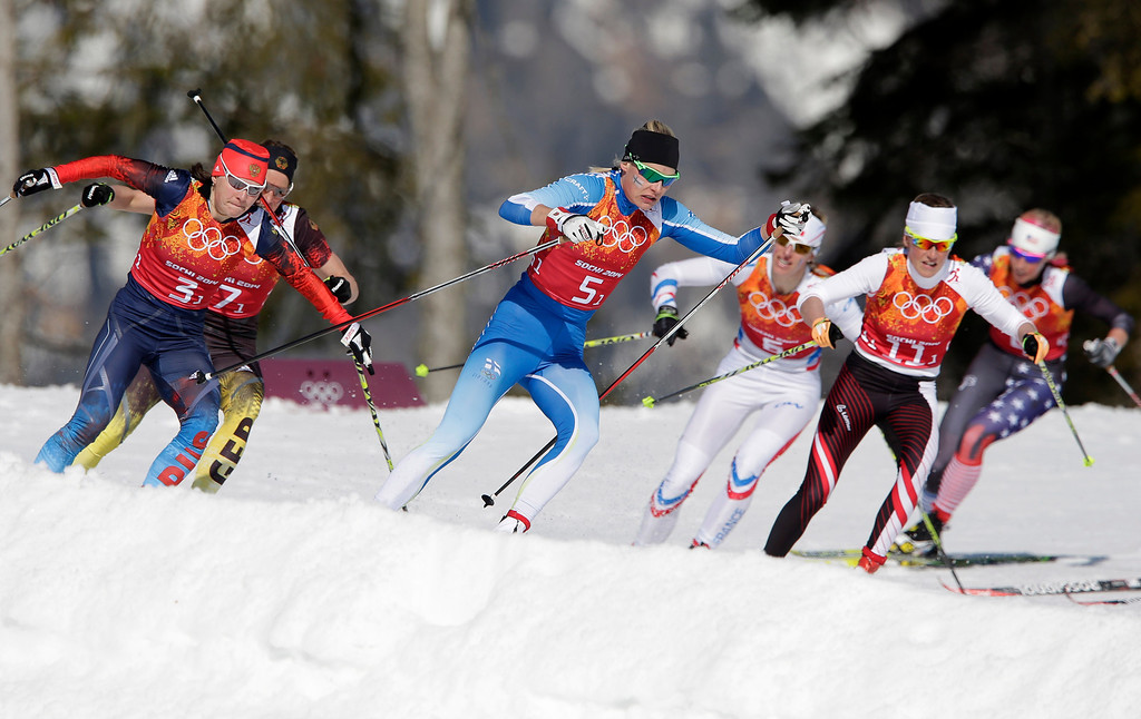 . Russia\'s Yulia Ivanova, Germany\'s Nicole Fessel, Finland\'s Anne Kylloenen, France\'s Aurore Jean, Norway\'s Heidi Weng, United States\' Kikkan Randall, from left, take a curve during the women\'s 4x5K cross-country relay at the 2014 Winter Olympics, Saturday, Feb. 15, 2014, in Krasnaya Polyana, Russia. (AP Photo/Matthias Schrader)