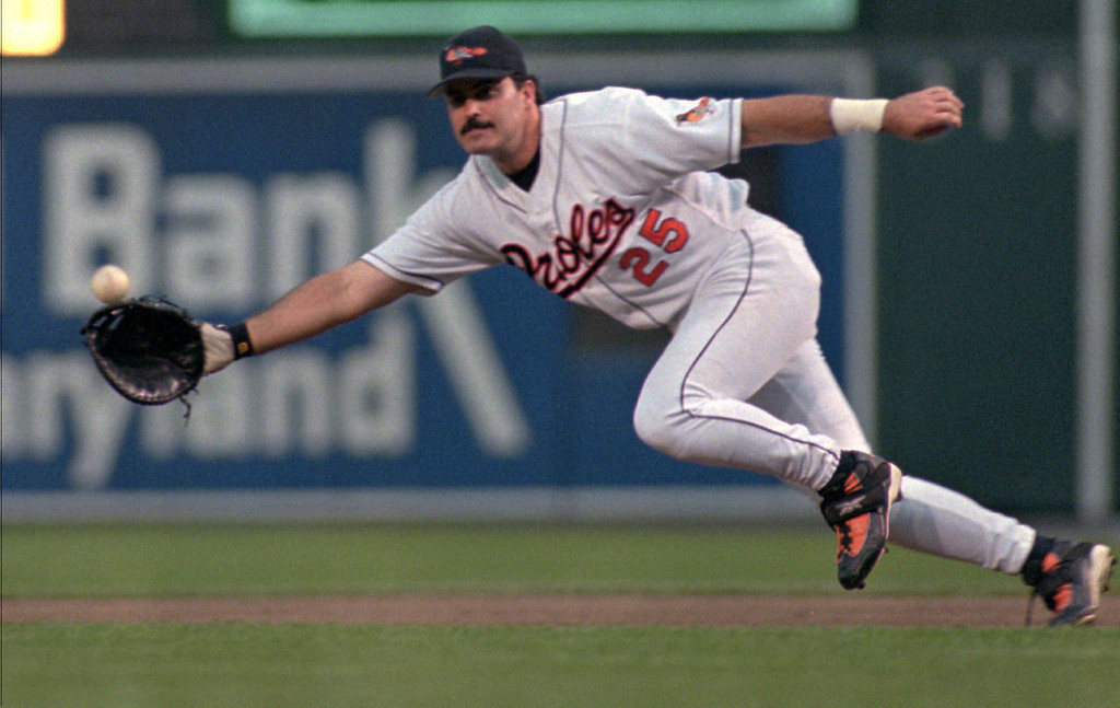 . RAFAEL PALMEIRO -- Baltimore Orioles first baseman Rafael Palmeiro dives for a second-inning single by New York Yankees\' Paul O\'Neill at Camden Yards in Baltimore, Wednesday, June 17, 1998. (AP Photo/Roberto Borea)