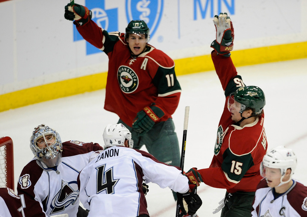 . ST PAUL, MN - JANUARY 19:  Goalie Semyon Varlamov #1 of the Colorado Avalanche reacts as Zach Parise #11 and Dany Heatley #15 of the Minnesota Wild celebrate a goal during the second period of their home opener on January 19, 2013 at Xcel Energy Center in St Paul, Minnesota. (Photo by Hannah Foslien/Getty Images)