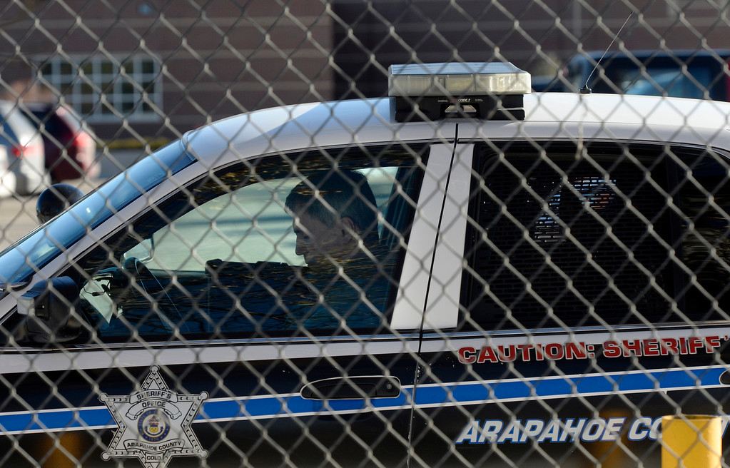 . A members of the Arapahoe County Sheriff\'s department secures a parking lot outside Arapahoe High School in Centennial, CO December 14, 2013. (Photo By Craig F. Walker / The Denver Post)