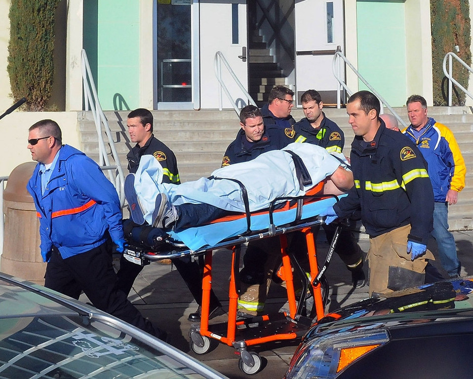 . This image provided by the Taft Midway Driller/Doug Keeler shows paramedics transporting a student wounded during a shooting Thursday Jan. 10, 2013 at San Joaquin Valley high school in Taft, Calif. Authorities said a student was shot and wounded and another student was taken into custody. (AP Photo/Taft  Midway Driller, Doug Keeler)
