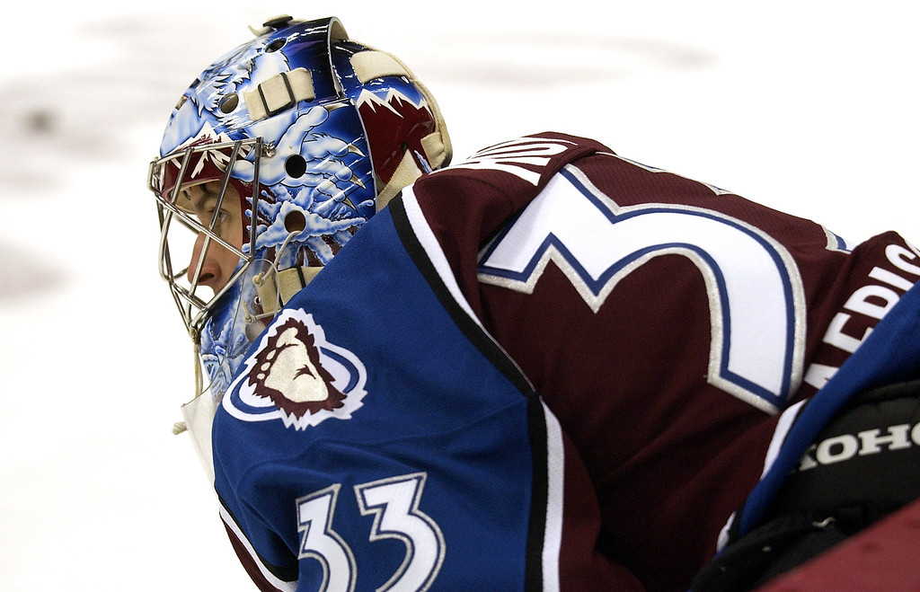 . Colorado Avalanche G David Aebischer takes a break during warm ups as he wears a Patrick Roy jersey. The jersey will be auctioned off on line.  (John Leyba/The Denver Post)