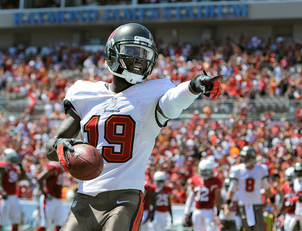 . Tampa Bay Buccaneers wide receiver Mike Williams (19) celebrates after catching a first quarter touchdown pass from quarterback Mike Glennon during the first quarter of an NFL football game against the Arizona Cardinals Sunday, Sept. 29, 2013, in Tampa, Fla. (AP Photo/Brian Blanco)