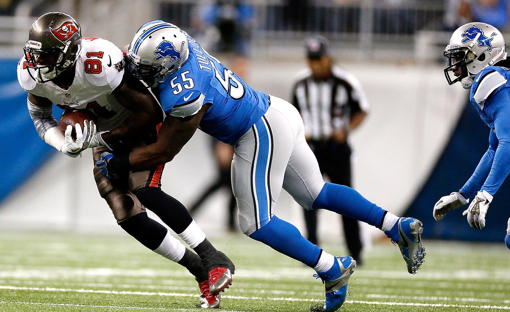 . Stephen Tulloch #55 of the Detroit Lions brings down Timothy Wright #81 of the Tampa Bay Buccaneers in the first quarter at Ford Field on November 24, 2013 in Detroit, Michigan. (Photo by Gregory Shamus/Getty Images)