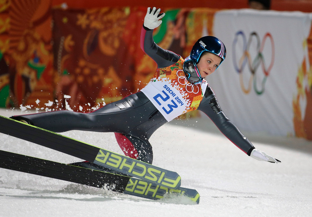 . Norway\'s Maren Lundby falls after her trial jump during the women\'s normal hill ski jumping final at the 2014 Winter Olympics, Tuesday, Feb. 11, 2014, in Krasnaya Polyana, Russia. (AP Photo/Gregorio Borgia)