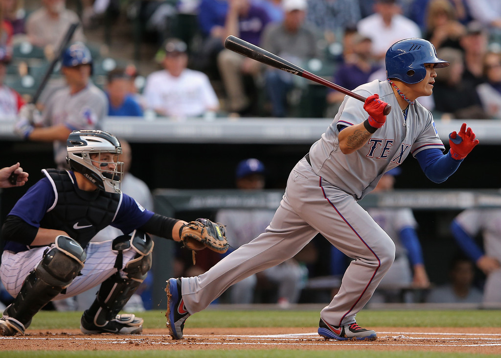 . Shin-Soo Choo #17 of the Texas Rangers grounds out against starting pitcher Jordan Lyles #24 of the Colorado Rockies in the first inning during Interleague play at Coors Field on May 5, 2014 in Denver, Colorado.  (Photo by Doug Pensinger/Getty Images)