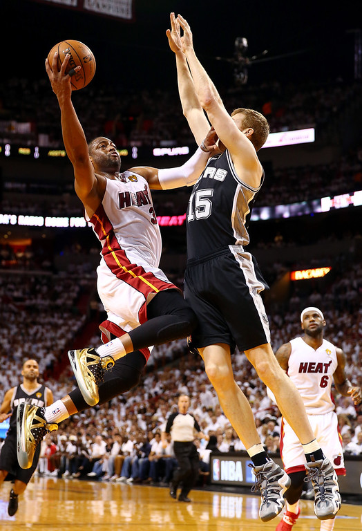 . MIAMI, FL - JUNE 12:  Dwyane Wade #3 of the Miami Heat goes up to the basket against Matt Bonner #15 of the San Antonio Spurs during Game Four of the 2014 NBA Finals at American Airlines Arena on June 12, 2014 in Miami, Florida. (Photo by Andy Lyons/Getty Images)