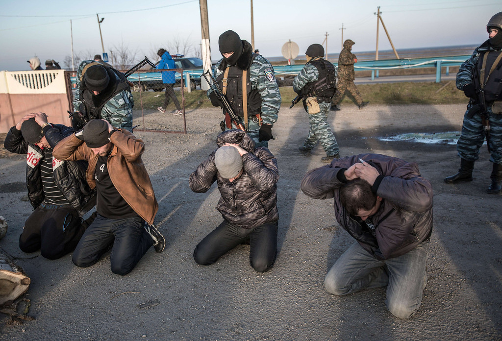 . Pro-Russian servicemen search people at Chongar checkpoint blocking the entrance to Crimea on March 10, 2014. Russia vowed on March 10 to unveil its own solution to the Ukrainian crisis that would run counter to US efforts and would appear to leave room for Crimea to switch over to Kremlin rule. The unexpected announcement came as Ukraine\'s new pro-European leaders raced to rally Western support in the face of the seizure by Kremlin-backed forces of the strategic Black Sea peninsula and plans to hold a Sunday referendum on switching Crimea\'s allegiance from Kiev to Moscow. ALISA BOROVIKOVA/AFP/Getty Images