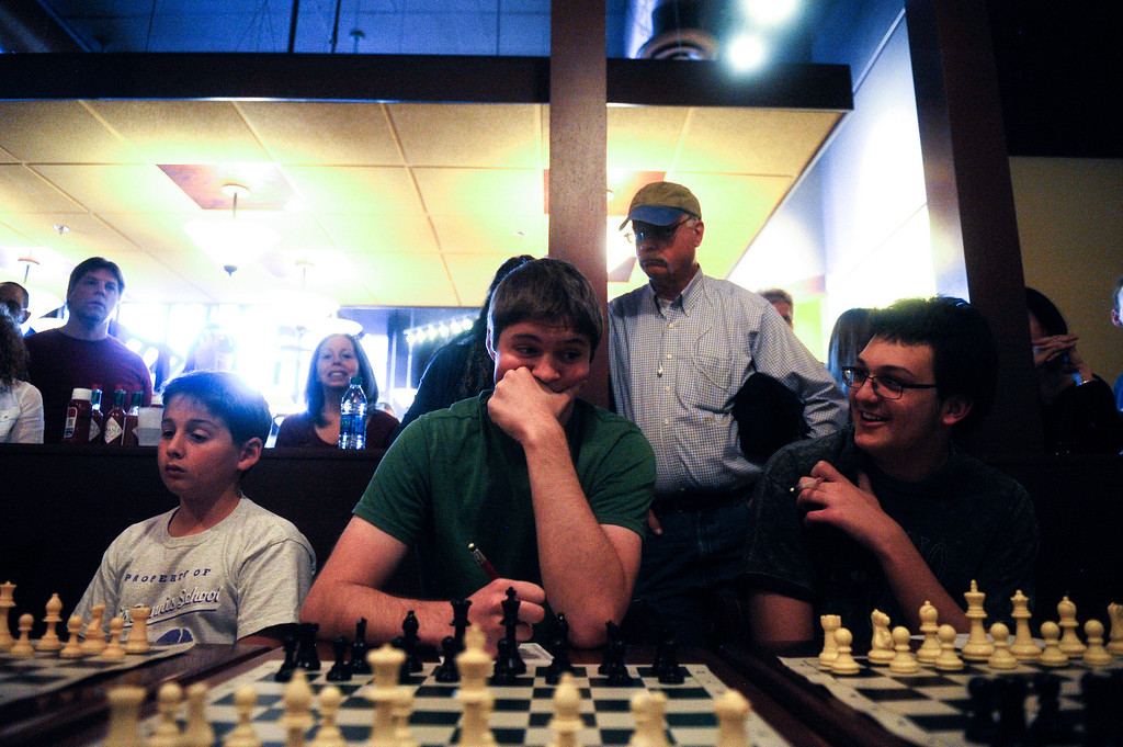 . DENVER CO: Nov. 2, 2013  Rhett Langseth (center) contemplates a move as he takes on grand chess master Timur Gareev on Nov. 2, 2013. Gareev took on Langseth and 14 others simultaneously while wearing a blindfold.  (Photo By Erin Hull/The Denver Post)