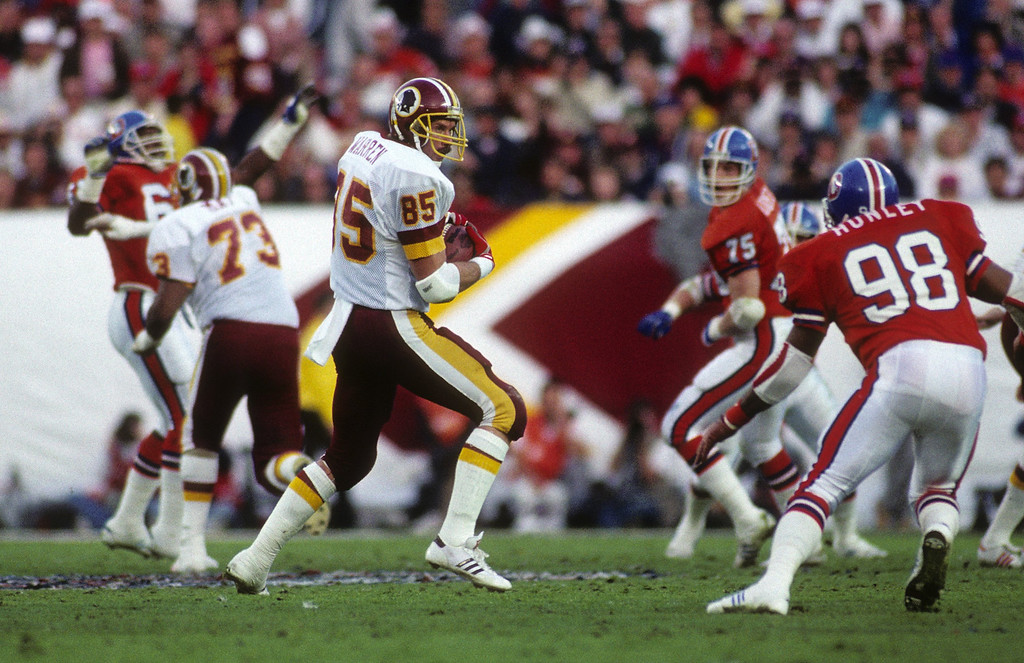 . Tight end Dave Truitt #85 of the Washington Redskins catches a pass under pressure from linebacker Ricky Hunley #98 of the Denver Broncos during Super Bowl XXII at Jack Murphy Stadium on January 31, 1988 in San Diego, California.   (Photo by George Rose/Getty Images)