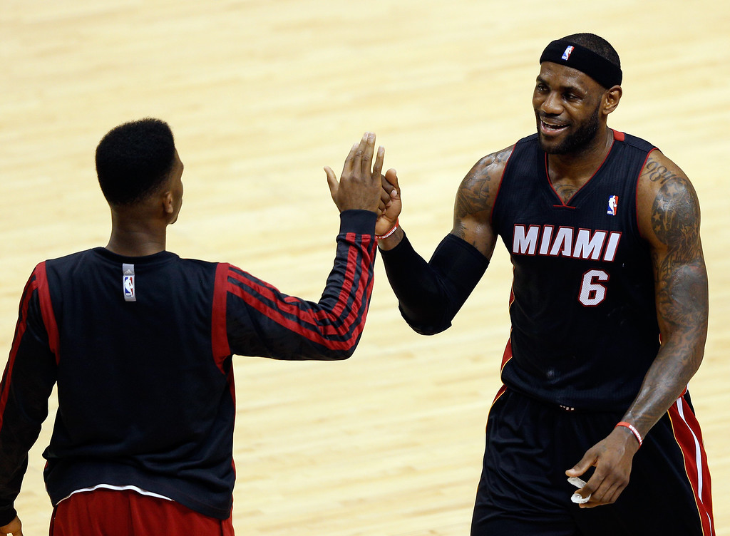 . INDIANAPOLIS, IN - MAY 28: LeBron James #6 celebrates with Norris Cole #30 of the Miami Heat against the Indiana Pacers during Game Five of the Eastern Conference Finals of the 2014 NBA Playoffs at Bankers Life Fieldhouse on May 28, 2014 in Indianapolis, Indiana.  (Photo by Joe Robbins/Getty Images)