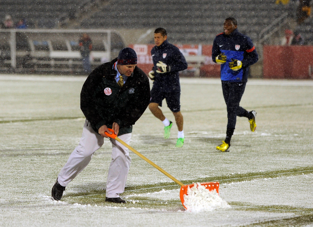 . COMMERCE CITY, CO. - MARCH 22: U.S. Men\'s National Soccer Team members warmed up as snow was shoveled from the field Friday night before the game. The U.S. Men\'s National Soccer Team hosted Costa Rica Friday night, March 22, 2013 in a FIFA World Cup qualifier at Dick\'s Sporting Goods Park in Commerce City.  (Photo By Karl Gehring/The Denver Post)