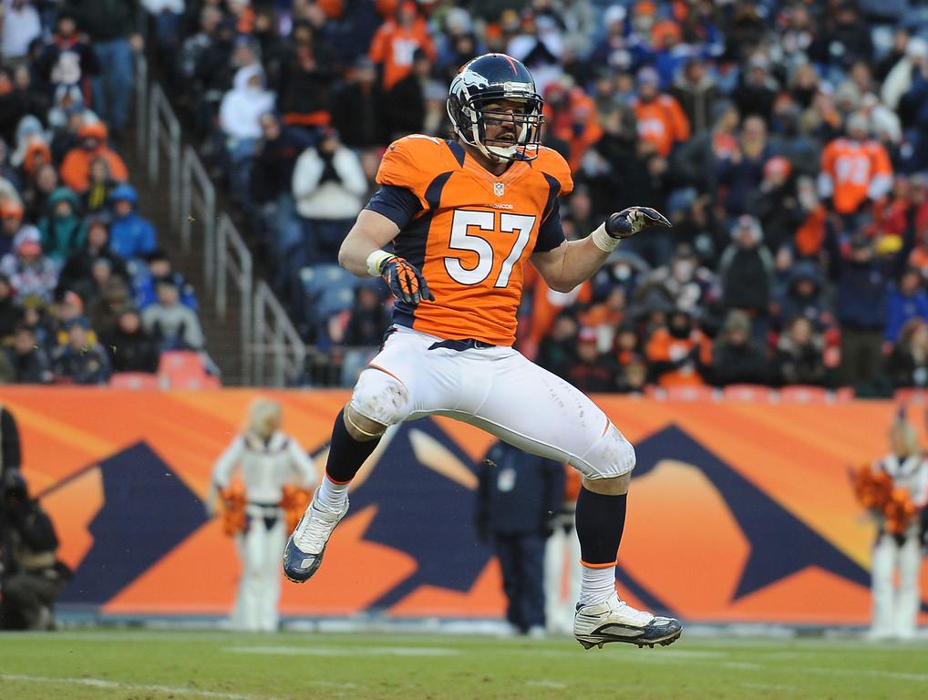 . Denver Broncos linebacker Keith Brooking celebrates his sack of Kansas City quarterback Brady Quinn in the third quarter Sunday at Sports Authority Field. Steve Nehf, The Denver Post