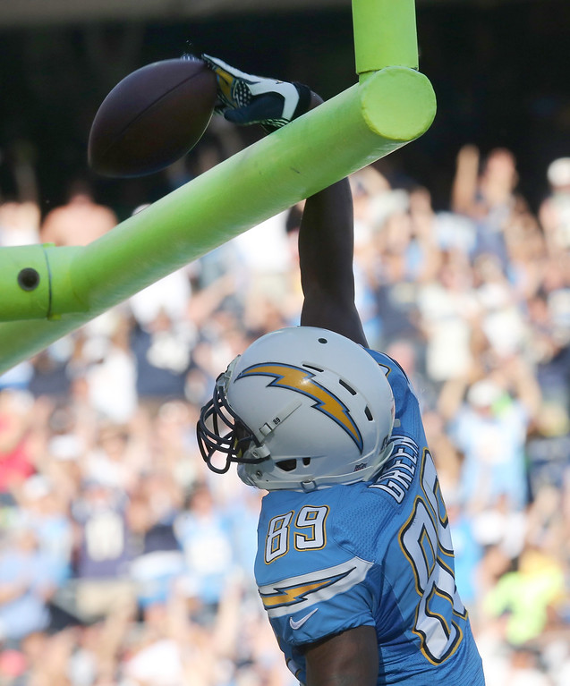 . Tight end Ladarius Green #89 of the San Diego Chargers spikes the ball over the goalpost after scoring on a 30 yard touchdown pass play in the second quarter against the Cincinnati Bengals at Qualcomm Stadium on December 1, 2013 in San Diego, California.  (Photo by Stephen Dunn/Getty Images)