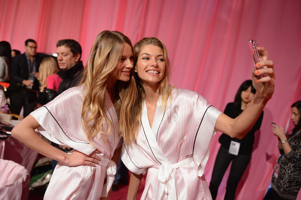 . Victoria\'s Secret models Ieva Laguna and Jessica Hart pose at the 2013 Victoria\'s Secret Fashion Show hair and make-up room at Lexington Avenue Armory on November 13, 2013 in New York City.  (Photo by Dimitrios Kambouris/Getty Images for Victoria\'s Secret)