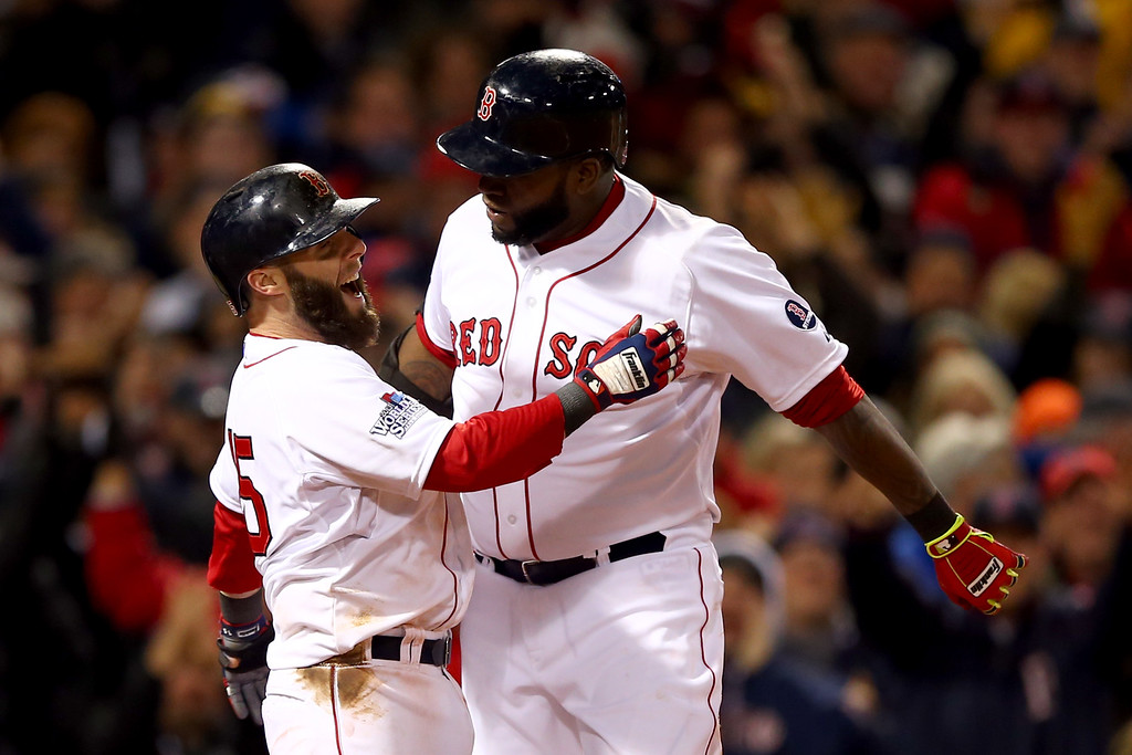 . BOSTON, MA - OCTOBER 24:  David Ortiz #34 of the Boston Red Sox celebrates with Dustin Pedroia #15 after hitting a two run home run in the sixth inning against the St. Louis Cardinals during Game Two of the 2013 World Series at Fenway Park on October 24, 2013 in Boston, Massachusetts.  (Photo by Elsa/Getty Images)