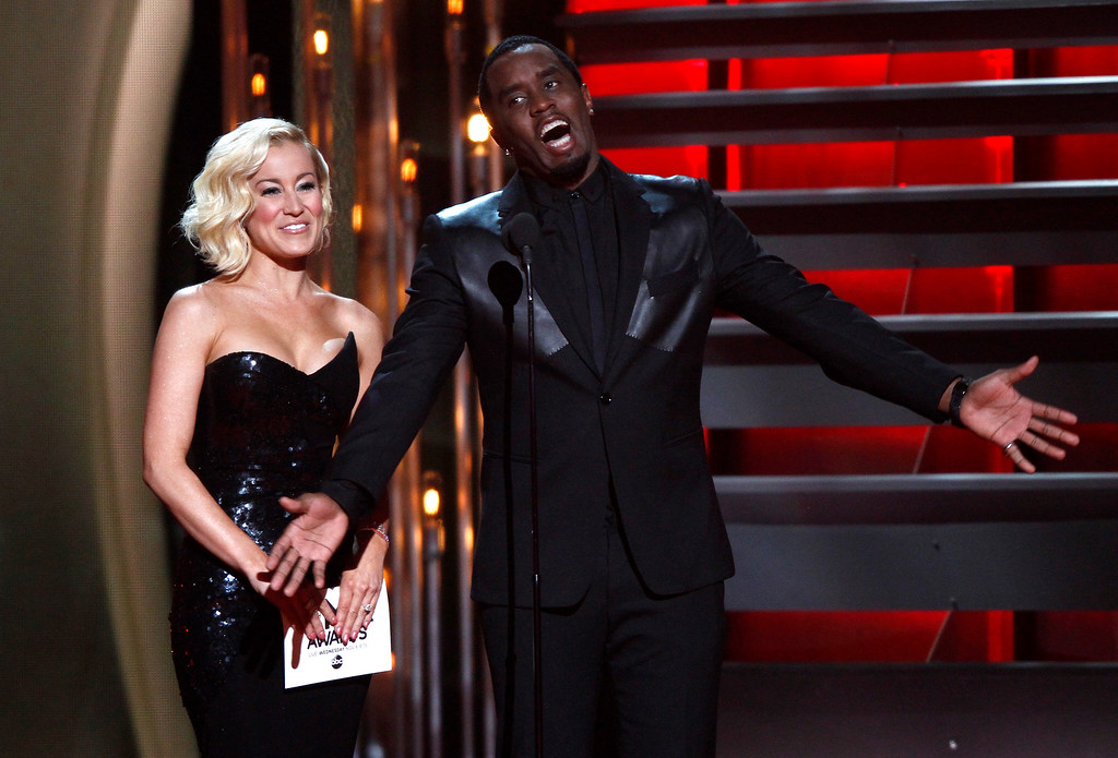 ". Kellie Pickler, left, and Sean ""Diddy\"" Combs present the award for vocal group of the year at the 47th annual CMA Awards at Bridgestone Arena on Wednesday, Nov. 6, 2013, in Nashville, Tenn. (Photo by Wade Payne/Invision/AP)"