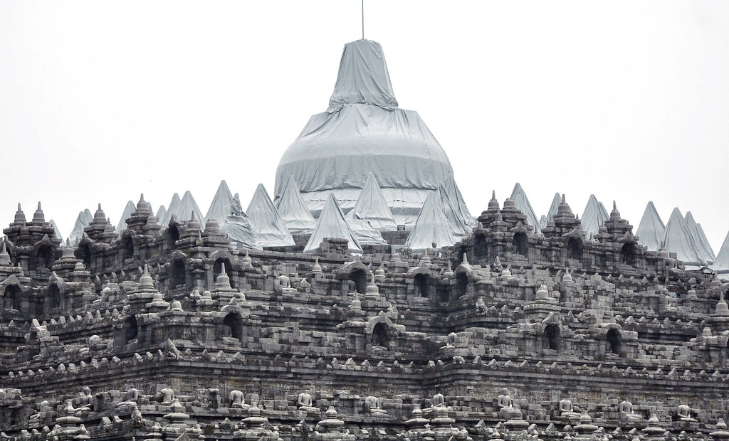 . Borobudur temple is partially covered with plastic sheets to protect from volcanic ash, from an eruption of Mount Kelud, in Magelang, central Java, Indonesia, Friday, Feb. 14, 2014.  (AP Photo/Slamet Riyadi)