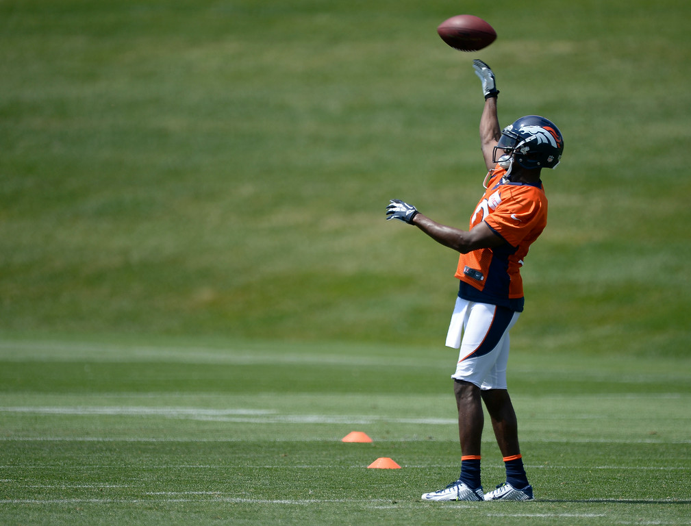 . Denver Broncos wide receiver Emmanuel Sanders (10) throws the football  during day two of the Denver Broncos 2014 training camp July 25, 2014 at Dove Valley. (Photo by John Leyba/The Denver Post)