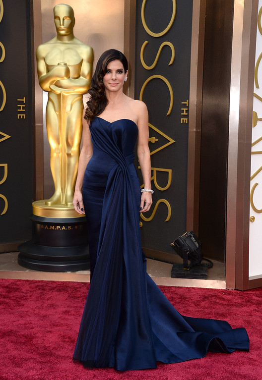. Sandra Bullock arrives at the Oscars on Sunday, March 2, 2014, at the Dolby Theatre in Los Angeles.  (Photo by Jordan Strauss/Invision/AP)