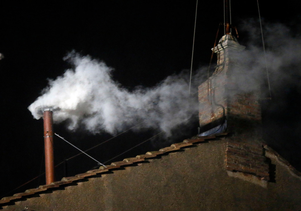 . White smoke emerges from the chimney on the roof of the Sistine Chapel, in St. Peter\'s Square at the Vatican, Wednesday, March 13, 2013. The white smoke indicates that the new pope has been elected. (AP Photo/Gregorio Borgia)