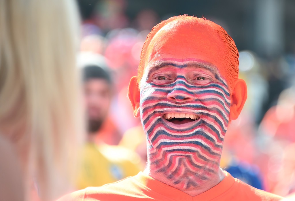 . A Netherlands fan attends the Group B football match between Netherlands and Chile at the Corinthians Arena in Sao Paulo during the 2014 FIFA World Cup on June 23, 2014. AFP PHOTO / DAMIEN  MEYER/AFP/Getty Images