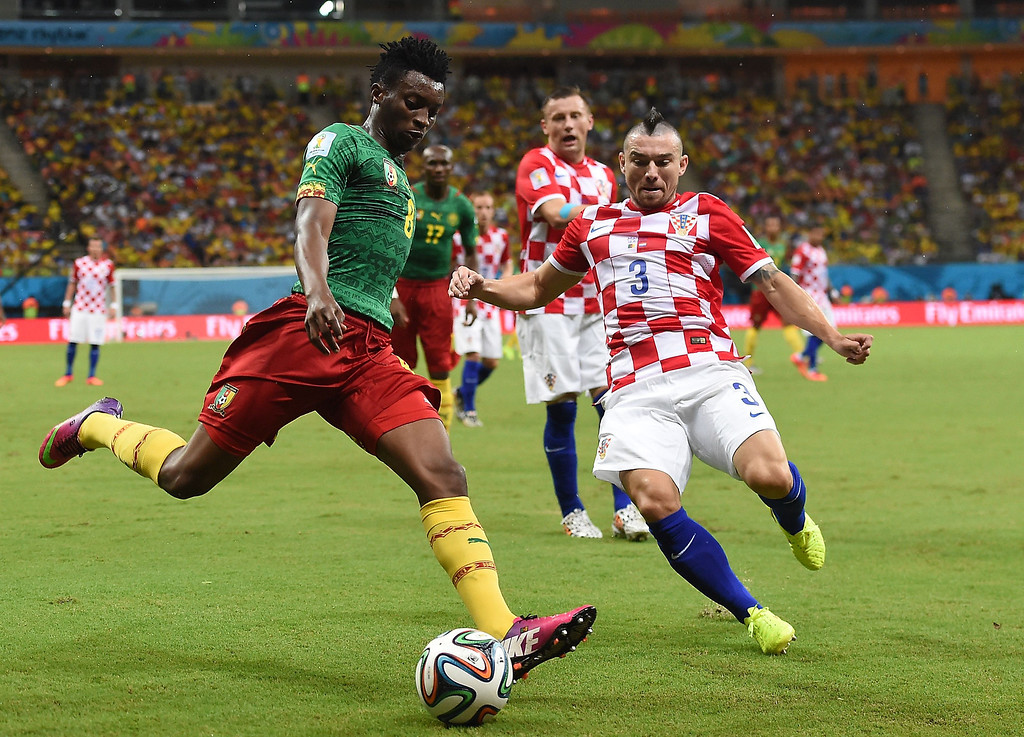 . Croatia\'s defender Danijel Pranjic (R) challenges Cameroon\'s forward Benjamin Moukandjo for the ball during the Group A football match between Cameroon and Croatia at The Amazonia Arena in Manaus on June 18, 2014, during the 2014 FIFA World Cup.  JAVIER SORIANO/AFP/Getty Images