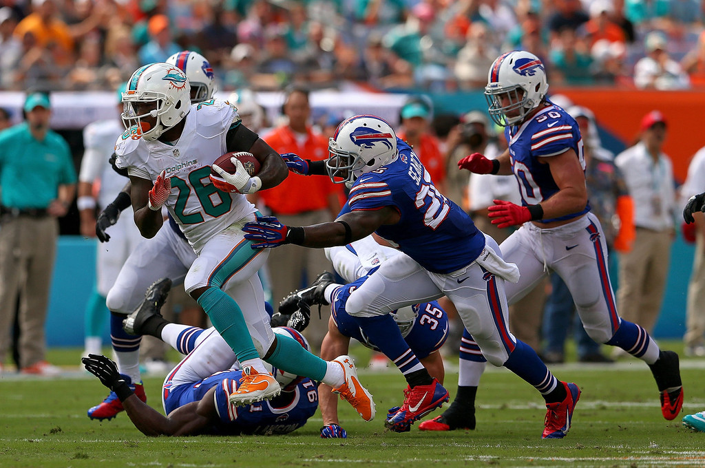 . Lamar Miller #26 of the Miami Dolphins rushes during a game against the Buffalo Bills at Sun Life Stadium on October 20, 2013 in Miami Gardens, Florida.  (Photo by Mike Ehrmann/Getty Images)