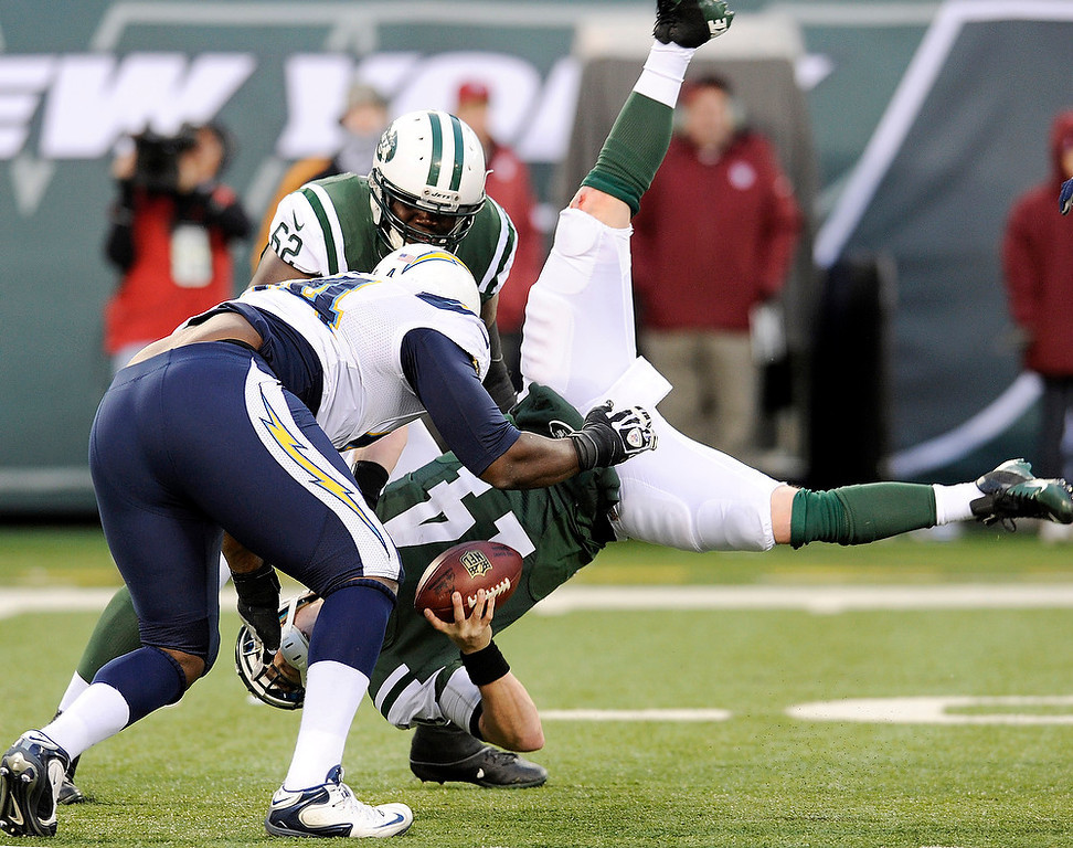 . New York Jets quarterback Greg McElroy, bottom, is sacked by San Diego Chargers defensive end Corey Liuget, left, during the second half of an NFL football game on Sunday, Dec. 23, 2012, in East Rutherford, N.J. The Chargers won 27-17. (AP Photo/Bill Kostroun)
