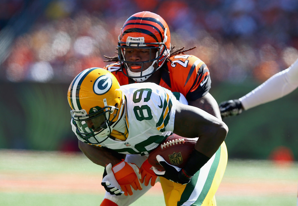 . James Jones #89 of the Green Bay Packers is tackled by Adam Jones #24 of the Cincinnati Bengals during the game at Paul Brown Stadium on September 22, 2013 in Cincinnati, Ohio.  (Photo by Andy Lyons/Getty Images)