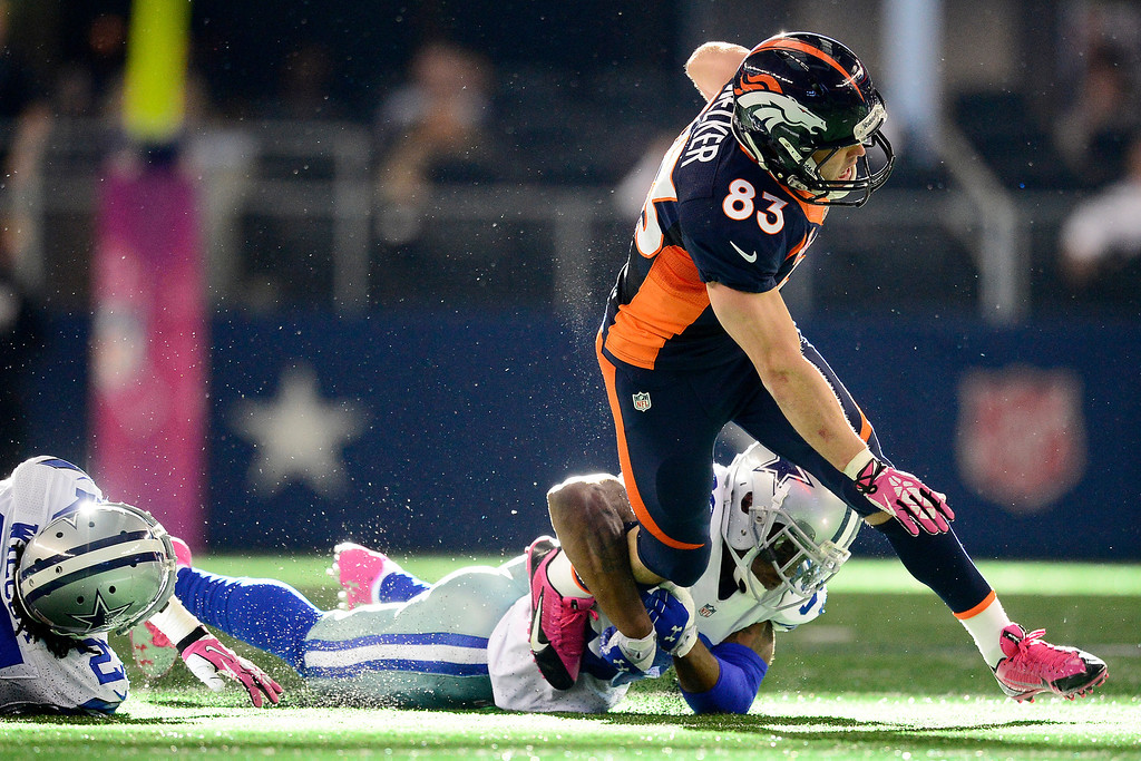 . ARLINGTON, TX - OCTOBER 6: Brandon Carr (39) of the Dallas Cowboys tackles Wes Welker (83) of the Denver Broncos during the second half of the Broncos\' 51-48 win at AT&T Stadium. The Denver Broncos visit the Dallas Cowboys. (Photo by AAron Ontiveroz/The Denver Post)