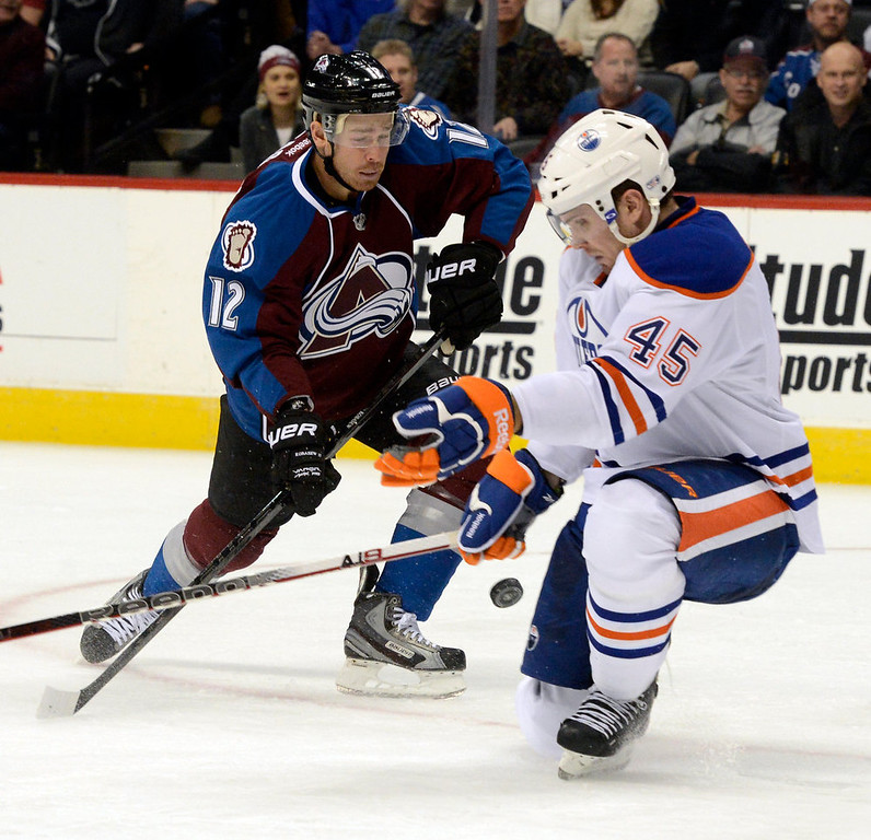 . DENVER, CO. - FEBRUARY 2ND: Chuck Kobasew, left, Colorado Avalanche, and Mark Fistric,  Edmonton Oilers, battle for control of the puck in the third period at the Pepsi Center in Denver Colorado, February 2nd, 2013.  (Photo By Andy Cross / The Denver Post)