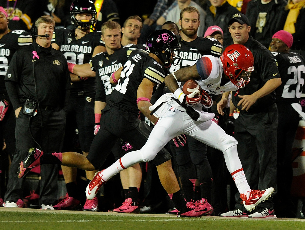 . BOULDER, CO. - OCTOBER 26: Colorado defensive back Jered Bell (21) pushed Arizona receiver Garic Wharton (16) out of bounds in the first half. The University of Colorado football team hosted Arizona Saturday night, October 26, 2013. Photo By Karl Gehring/The Denver Post