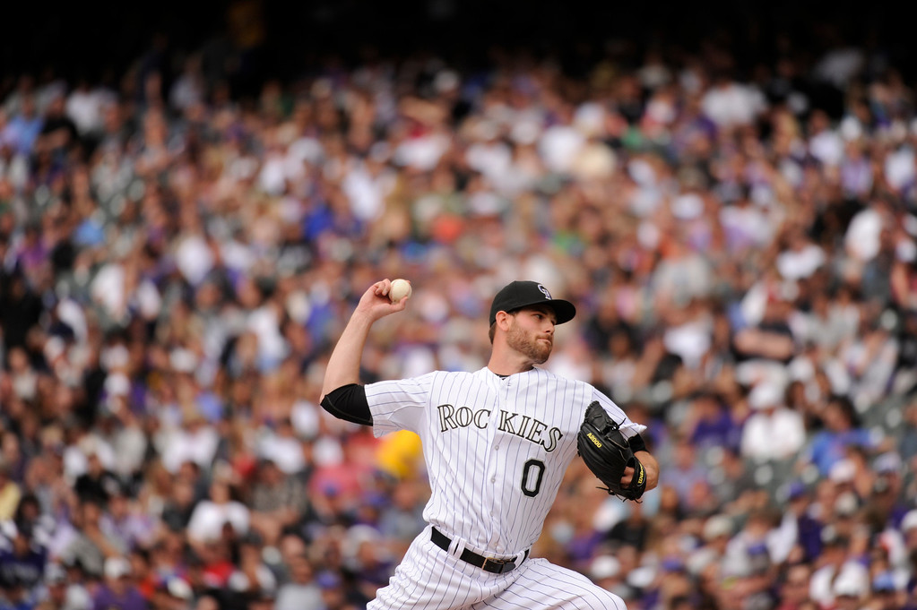 . Adam Ottavino (0) of the Colorado Rockies delivers a pitch in the seventh inning. (Photo by Karl Gehring/The Denver Post)