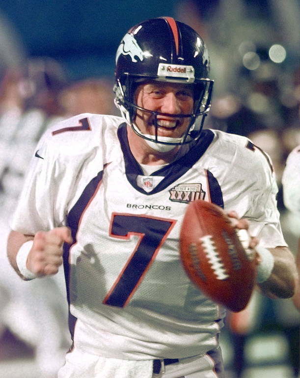 . Denver Broncos quarterback John Elway celebrates after scoring on a quarterback keeper in the fourth quarter of Super Bowl XXXIII against the Atlanta Falcons in Miami, Sunday, Jan. 31, 1999. The Broncos defeated the Falcons 34-19. Elway was named the MVP of the Super Bowl. (AP Photo/David Zalubowski)