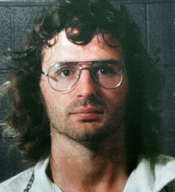 . This 1998 file photo shows Branch Davidian leader David Koresh in a police line-up following a gun battle with former Davidians. (AP Photo/Waco Tribune Herald)
