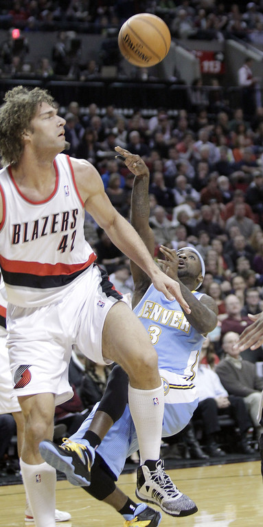 . Denver Nuggets guard Ty Lawson, right, gets off a shot as he is fouled by Portland Trail Blazers center Robin Lopez during the first half of an NBA basketball game in Portland, Ore., Thursday, Jan. 23, 2014. (AP Photo/Don Ryan)