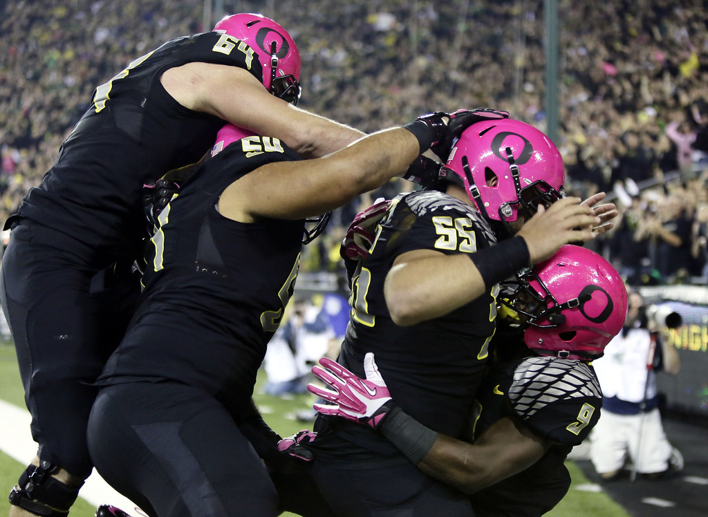 . Oregon running back Byron Marshall, right, celebrates his touchdown with teammates, from left, Tyler Johnstone, Hamani Stevens and Hroniss Grasu during the first half of an NCAA college football game against Washington State in Eugene, Ore., Saturday, Oct. 19, 2013. (AP Photo/Don Ryan)