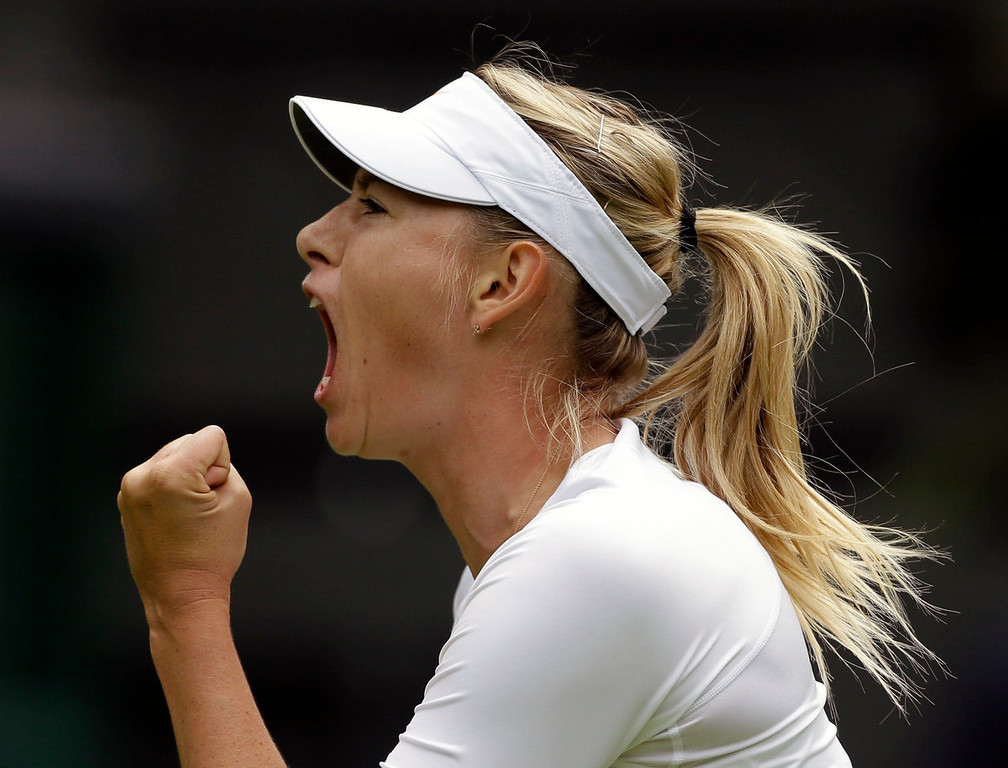 . Maria Sharapova of Russia reacts after winning the first set against Kristina Mladenovic of France during their Women\'s first round singles match at the All England Lawn Tennis Championships in Wimbledon, London, Monday, June 24, 2013.  (AP Photo/Anja Niedringhaus)