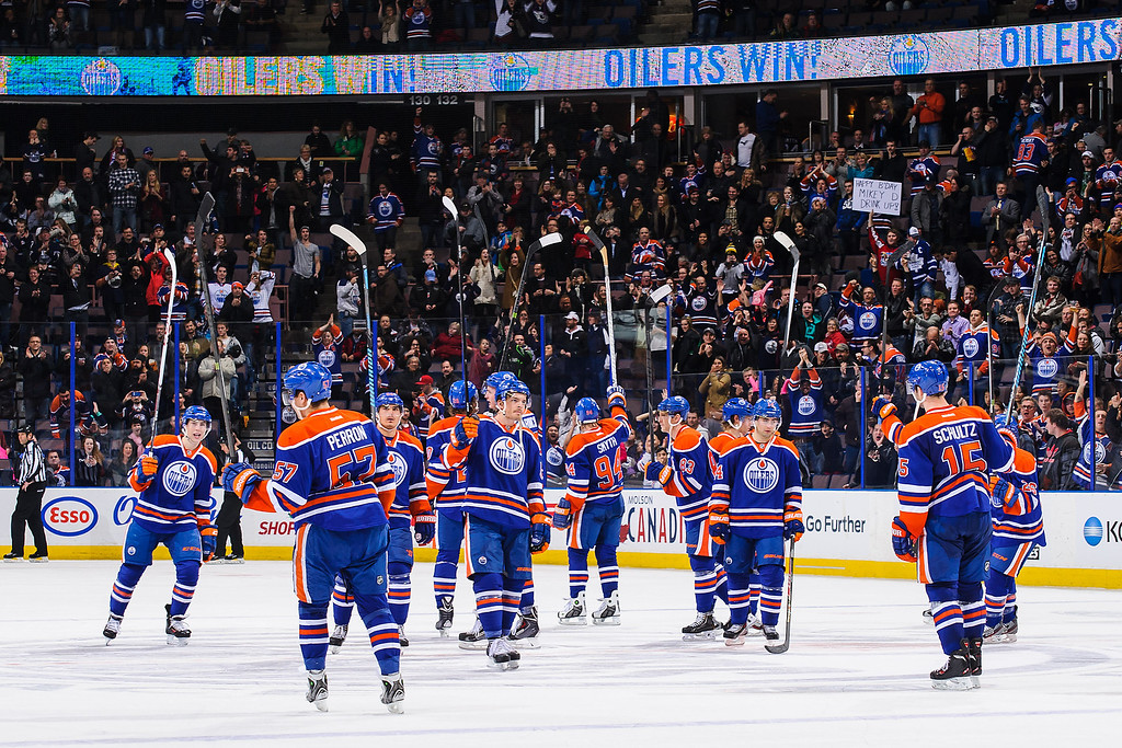 . EDMONTON, AB - DECEMBER 5: Members of the Edmonton Oilers salute the crowd after their defeat over the Colorado Avalanche at Rexall Place on December 5, 2013 in Edmonton, Alberta, Canada. The Oilers defeated the Avalanche 8-2. (Photo by Derek Leung/Getty Images)