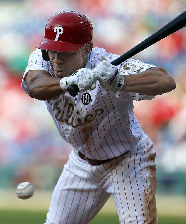 . Ben Revere #2 of the Philadelphia Phillies avoids an inside pitch against the Colorado Rockies during a game at Citizens Bank Park on May 26, 2014 in Philadelphia, Pennsylvania.The Phillies defeated the Rockies 9-0. (Photo by Rich Schultz/Getty Images)