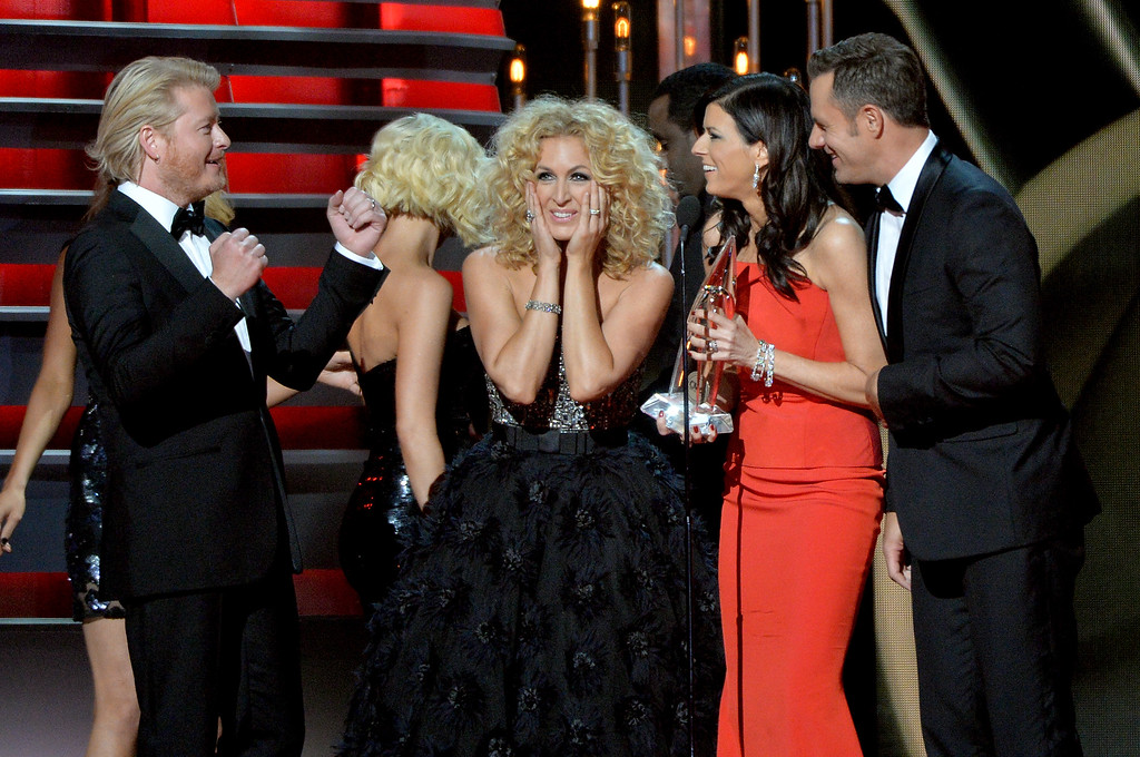 . NASHVILLE, TN - NOVEMBER 06:  Vocal Group of the Year award winners Little Big Town, (L-R) Philip Sweet, Kimberly Schlapman, Karen Fairchild and Jimi Westbrook onstage during the 47th annual CMA awards at the Bridgestone Arena on November 6, 2013 in Nashville, United States.  (Photo by Rick Diamond/Getty Images)
