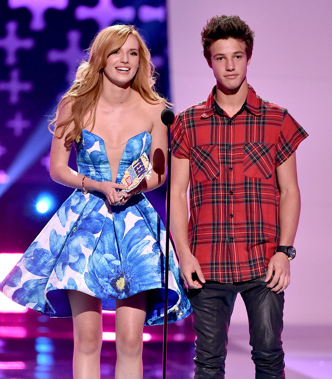 . Actress Bella Thorne (L) and internet personality Cameron Dallas onstage during FOX\'s 2014 Teen Choice Awards at The Shrine Auditorium on August 10, 2014 in Los Angeles, California.  (Photo by Kevin Winter/Getty Images)